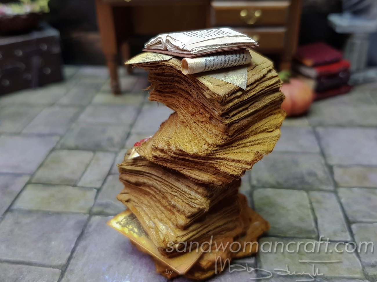 Miniature aged papers stacked