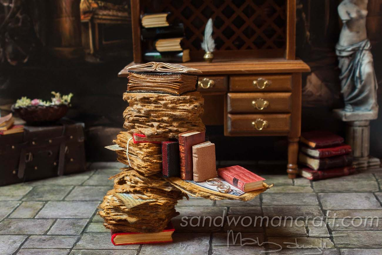 Dollhouse miniatures pile with aged papers and books