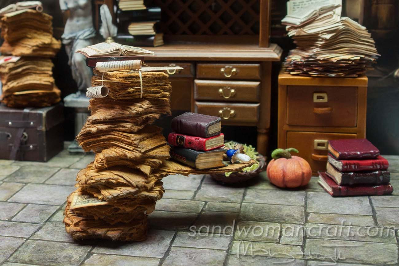 Miniature library with aged papers