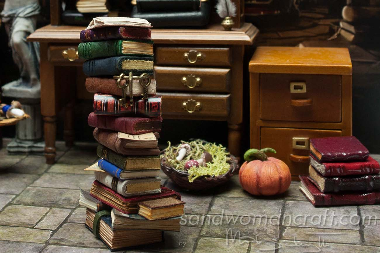 Miniature library with leather books stacked