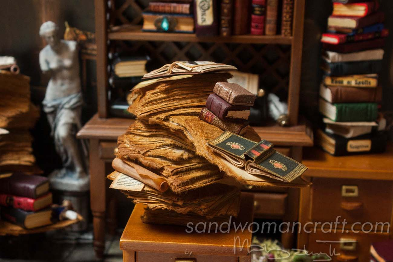 Aged paper pile with leather books