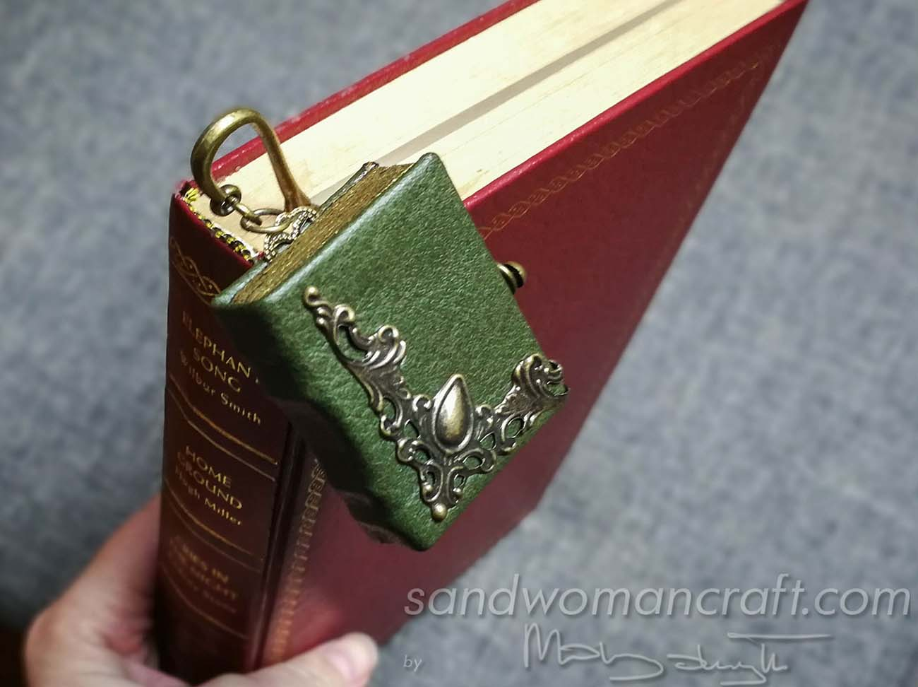 Miniature book is embellished with metal filigree
