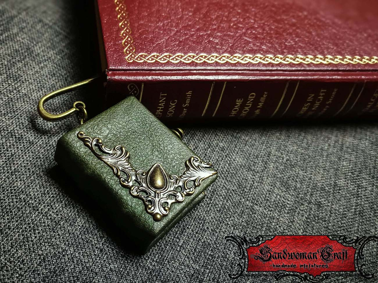 Bookmark page marker with miniature green leather book