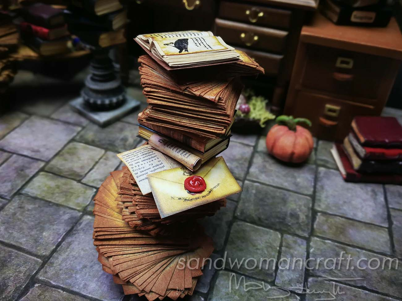 Miniature paper stack with Crow book and wax sealed envelope letter
