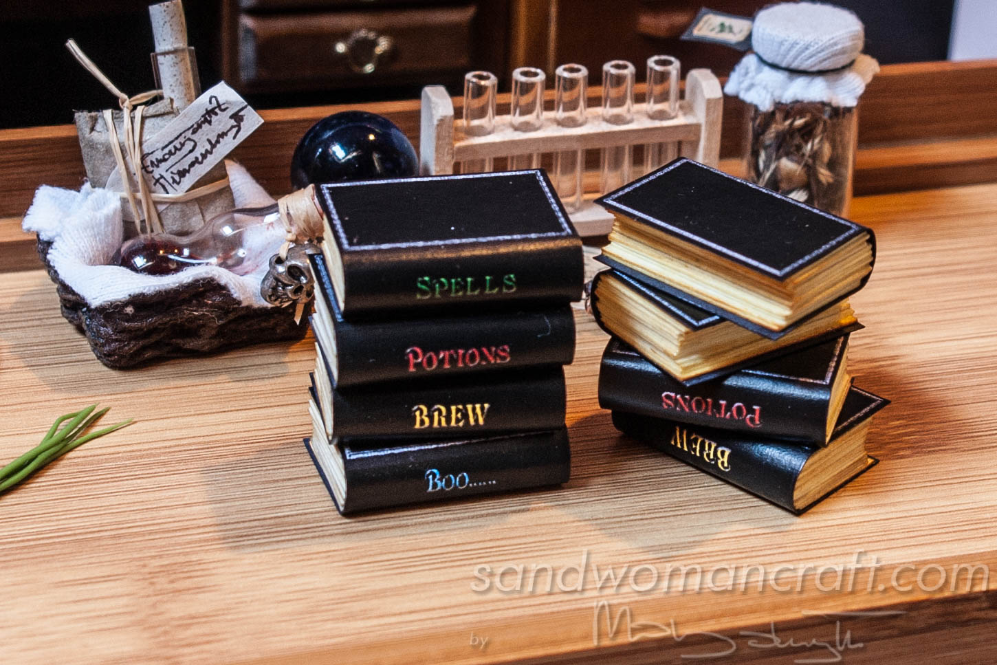 Set of four miniature books