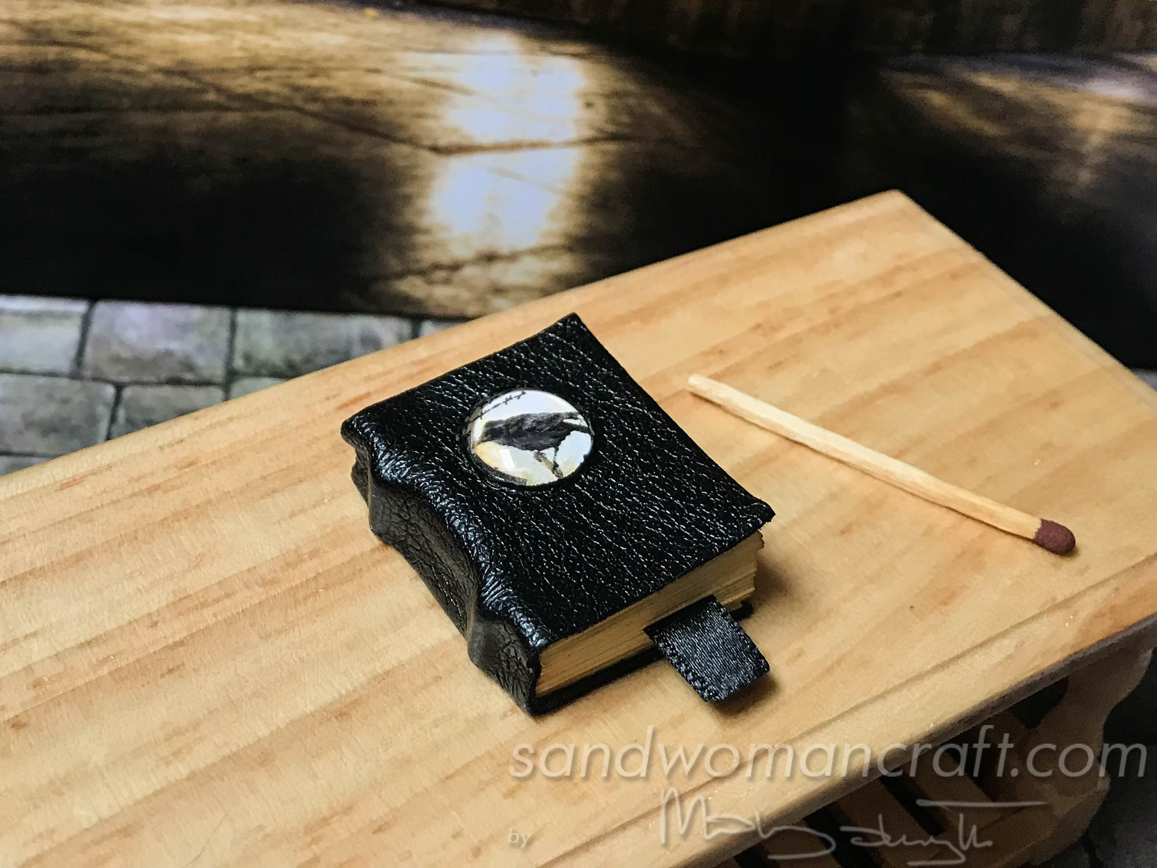 Miniature leather book with crow cabochon
